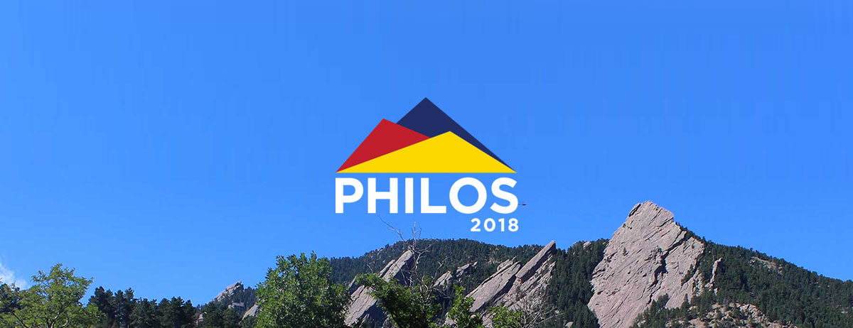 Philos 2018 Logo overlaid on image of mountain range